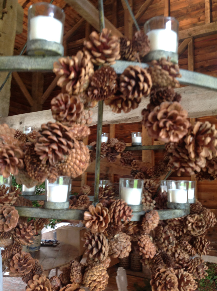 Around the barn's rustic chandelier, we used pine cone roping
