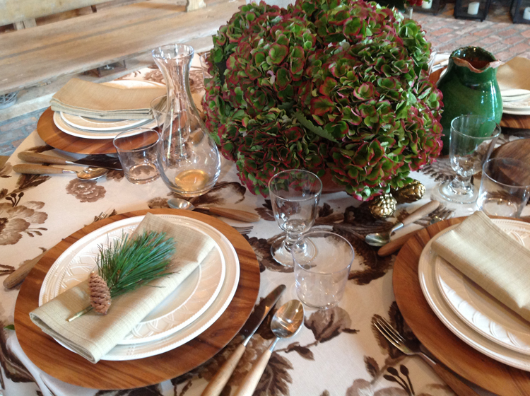 The table featured Aerin's wood chargers, china and stemware - all from her Aerin  Collection - I used antigue green hydrangeas and laid a sprig of pine and a pinecone on each napkin