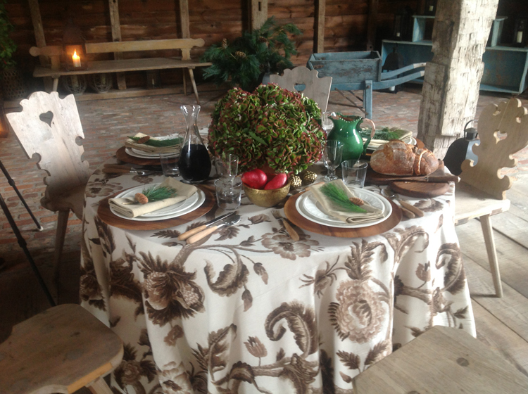 We added red pears to Aerin's gold bowls and even put out a warm loaf of bread to complete the table and make it perfect for lunch...large containers of pine were placed around the barn, lanterns were used for lighting